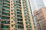 China, Guangdong Province, Guangzhou, high rise apartment building with green glass windows Stock Photo - Premium Royalty-Free, Artist: Aurora Photos, Code: 632-01637869
