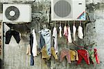 Laundry hanging to dry on cables Stock Photo - Premium Royalty-Free, Artist: Transtock, Code: 632-01637948