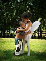 people kissing little boys - Girl and Boy Hugging in Yard    Stock Photo - Premium Royalty-Freenull, Code: 600-01644678