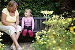 Grandmother and Granddaughter Sitting on Bench in Garden    Stock Photo - Premium Royalty-Free, Artist: Masterfile, Code: 600-01645165