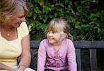 Grandmother and Granddaughter Sitting on Bench in Garden    Stock Photo - Premium Royalty-Free, Artist: Masterfile, Code: 600-01645166