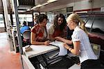 Women in Service Station    Stock Photo - Premium Royalty-Free, Artist: Masterfile, Code: 600-01645953