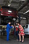 Women and Mechanic in Service Station    Stock Photo - Premium Royalty-Free, Artist: Masterfile, Code: 600-01645963