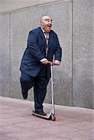 fat man exercising - Businessman on Scooter    Stock Photo - Premium Royalty-Freenull, Code: 600-01646038