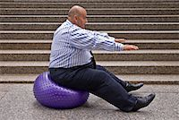 fat man balls - Businessman Using Exercise Ball    Stock Photo - Premium Royalty-Freenull, Code: 600-01646039