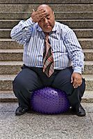 fat man balls - Businessman Using Exercise Ball    Stock Photo - Premium Royalty-Freenull, Code: 600-01646041