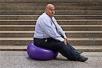 fat man balls - Businessman Using Exercise Ball    Stock Photo - Premium Royalty-Freenull, Code: 600-01646042