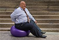 fat man balls - Businessman Using Exercise Ball    Stock Photo - Premium Royalty-Freenull, Code: 600-01646043