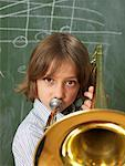 Boy Playing Trombone in Classroom Stock Photo - Premium Rights-Managed, Artist: Edward Pond, Code: 700-01646390