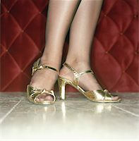 stocking feet - Female feet in high heels Stock Photo - Premium Royalty-Freenull, Code: 653-01652799