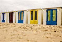 Beach huts on sand in a row Stock Photo - Premium Royalty-Freenull, Code: 653-01656732
