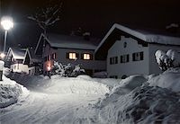 Snow covered cabins at night Stock Photo - Premium Royalty-Freenull, Code: 653-01657478