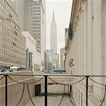 View along street of Empire State Building on overcast day, Manhattan Stock Photo - Premium Royalty-Free, Artist: Arcaid, Code: 653-01660341