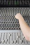 Hand operating sound mixer Stock Photo - Premium Royalty-Free, Artist: AWL Images, Code: 653-01660682