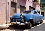 Old blue car parked in street, Havana, Cuba