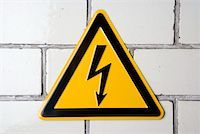 A 'High voltage' warning sign Stock Photo - Premium Royalty-Freenull, Code: 653-01662089