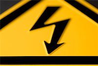 Close-up of 'High voltage' warning sign Stock Photo - Premium Royalty-Freenull, Code: 653-01662159