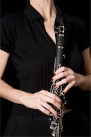 Woman holding a clarinet Stock Photo - Premium Royalty-Freenull, Code: 653-01662404