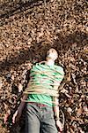 Man lying on the ground, bound in rope and with adhesive tape covering his mouth Stock Photo - Premium Royalty-Free, Artist: Westend61, Code: 653-01662805