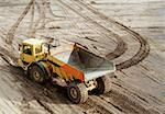 Dump truck on muddy ground Stock Photo - Premium Royalty-Free, Artist: Masterfile, Code: 653-01665599