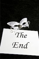 A mask and a sign for 'The End' on a theater stage Stock Photo - Premium Royalty-Freenull, Code: 653-01665917