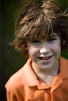 preteen  smile  one  alone - Portrait of a young boy with red hair Stock Photo - Premium Royalty-Freenull, Code: 653-01666261