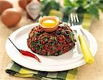 Steak tartare with hot peppers and capers Stock Photo - Premium Royalty-Freenull, Code: 652-01669397