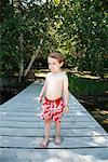 Boy on Dock    Stock Photo - Premium Rights-Managed, Artist: Mark Peter Drolet, Code: 700-01670784