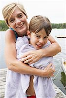 preteen swimsuit - Mother Drying Son off on Dock    Stock Photo - Premium Royalty-Freenull, Code: 600-01694211