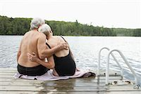fat woman in bathing suit - Couple Sitting on Dock    Stock Photo - Premium Royalty-Freenull, Code: 600-01694217