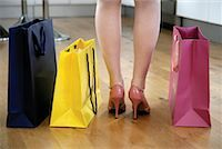 Woman's Legs with Shopping Bags    Stock Photo - Premium Rights-Managed, Artist: Steve McDonough, Code: 700-01694276