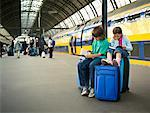Children Waiting with Luggage at Train Station    Stock Photo - Premium Rights-Managed, Artist: Matthew Plexman, Code: 700-01694799