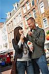 Couple Eating Snack in Market, Amsterdam, Netherlands    Stock Photo - Premium Rights-Managed, Artist: Masterfile, Code: 700-01695502