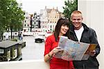Couple by Canal with Map, Amsterdam, Netherlands    Stock Photo - Premium Rights-Managed, Artist: Masterfile, Code: 700-01695514