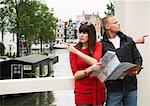 Couple by Canal with Map, Amsterdam, Netherlands    Stock Photo - Premium Rights-Managed, Artist: Masterfile, Code: 700-01695516