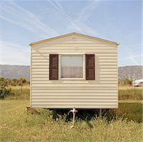 A mobile home in a field Stock Photo - Premium Royalty-Freenull, Code: 653-01697268