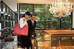 Two people looking at jewelry in display cabinets Stock Photo - Premium Royalty-Free, Artist: Blend Images, Code: 653-01698695