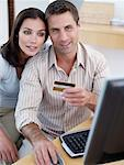 Man with credit card and computer with woman Stock Photo - Premium Royalty-Freenull, Code: 635-01705508