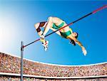 Athlete high jumping in an arena Stock Photo - Premium Royalty-Free, Artist: Cultura RM, Code: 635-01705663