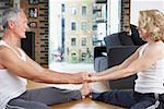 Couple doing yoga in living room Stock Photo - Premium Royalty-Free, Artist: Mark Peter Drolet, Code: 635-01706771