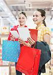 Two girls looking at cards in store Stock Photo - Premium Royalty-Free, Artist: Jerzyworks, Code: 635-01707099