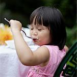 Girl eating outdoors Stock Photo - Premium Royalty-Free, Artist: Masterfile, Code: 635-01707112