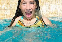 preteen swimsuit - Girl in swimming pool with mouth open Stock Photo - Premium Royalty-Freenull, Code: 635-01707281