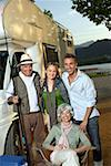 Two couples outside recreational vehicle with fishing pole Stock Photo - Premium Royalty-Free, Artist: Cultura RM, Code: 635-01707313