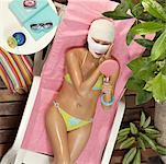 Woman in swimwear with face wrapped in gauze Stock Photo - Premium Royalty-Free, Artist: Blend Images, Code: 635-01707558