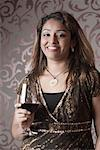 Portrait of a young woman holding a glass of wine and smiling Stock Photo - Premium Royalty-Free, Artist: Jose Luis Stephens, Code: 630-01707999
