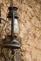 Close-up of a lantern hanging on a wall Stock Photo - Premium Royalty-Freenull, Code: 630-01708406