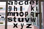 Close-up of alphabets written on a window pane Stock Photo - Premium Royalty-Free, Artist: Westend61, Code: 630-01708546