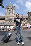 Tourist standing outside Railroad station, Chhatrapati Shivaji, Terminus, Mumbai, Maharashtra, India