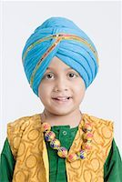 punjabi - Portrait of a boy smiling Stock Photo - Premium Royalty-Freenull, Code: 630-01708779